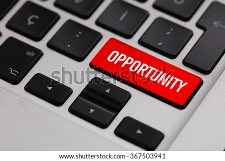 Black keyboard with red OPPORTUNITY button - stock photo