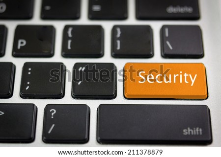Black keyboard with word Security  on the orange keyboard key - stock photo