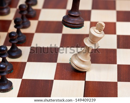 Black King knocks white king on chess board