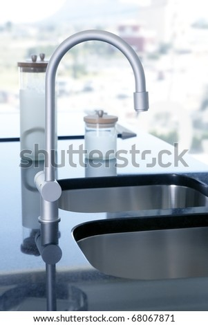 black kitchen stove curved silver stainless steel sinks window background - stock photo