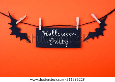 Black Label with the Words Halloween Party on Orange Background - stock photo