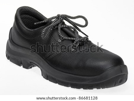 black lace-up shoe made of leather in white back - stock photo