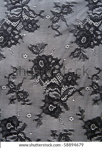 Black lace with pattern from flower on white background - stock photo