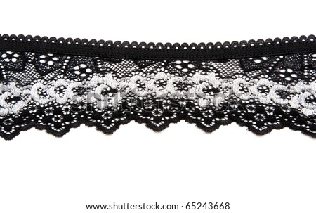 Black lace with pattern in the manner of white flower on white background