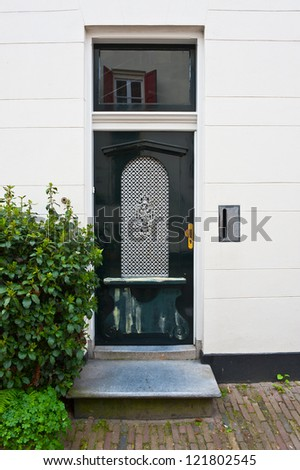 Black Lacquered Door in the Dutch City