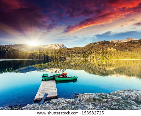 Black lake in Durmitor national park in Montenegro. Dramatic overcast sky. Balkans, Europe. Beauty world.  - stock photo