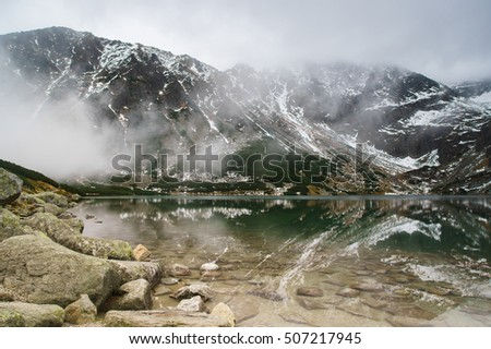 black lake in Tatry mountains, Poland - a remarkable reflection in water
