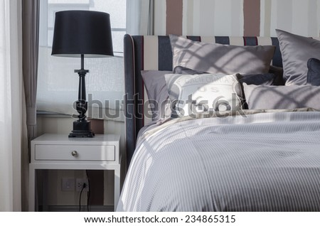 black lamp on grey table in bedroom at home - stock photo