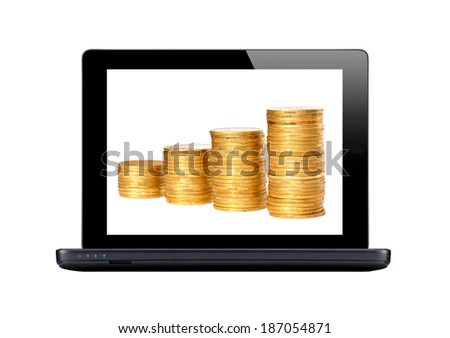 Black laptop and golden coins on screen isolated on white - stock photo