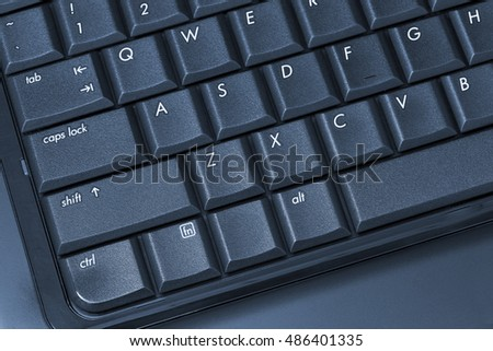 Black laptop keyboard close up