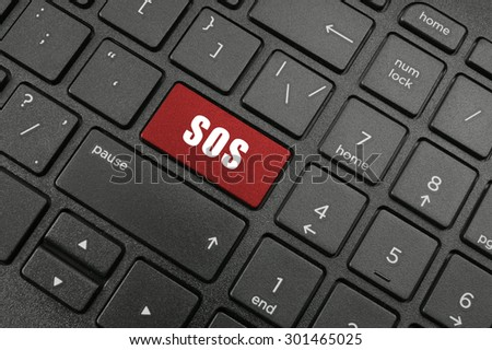 Black laptop keyboard with sos button