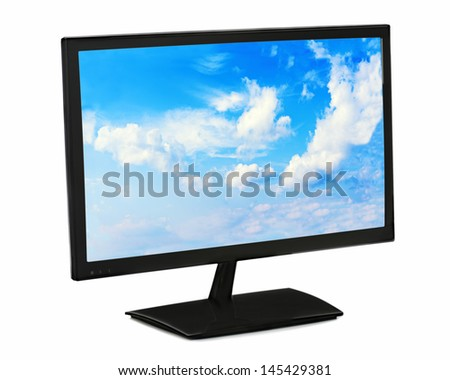 Black lcd monitor with blue sky isolated on white background. Closeup.