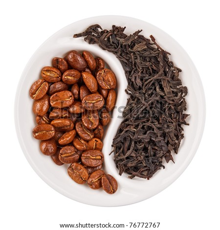 Black leaf tea versus coffee beans in Yin Yang shaped plate, isolated on white - stock photo