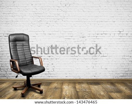 Black leather armchair in room. Business interior background - stock photo