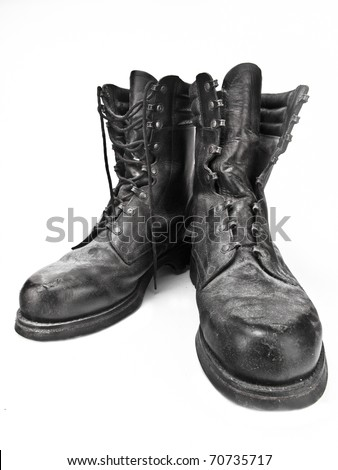 Black leather army boots - Old, destroyed and dusty - stock photo