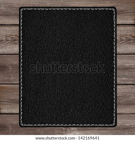 black leather background on wooden plank brown texture