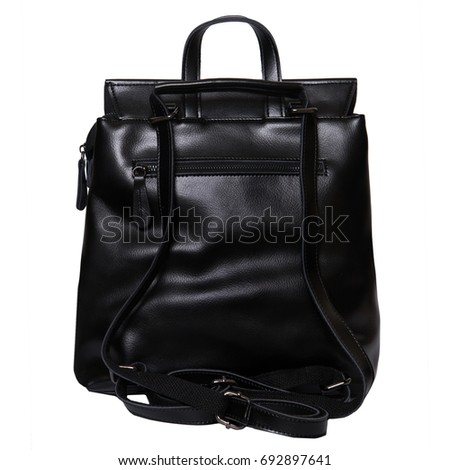 Black leather backpack standing isolated on white background