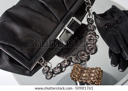 Black Leather Bag and short gloves - stock photo