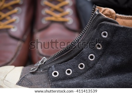 black leather boot with zipper