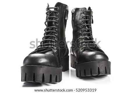 Black leather boots isolated on white background