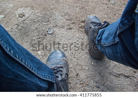 Black leather boots on ground - stock photo