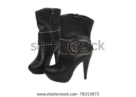 black leather boots with  on the platform and high heels - stock photo