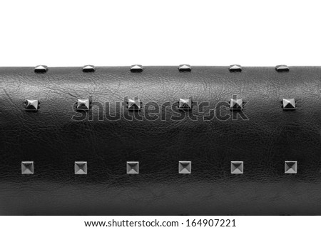 black leather bracelet with spikes - stock photo