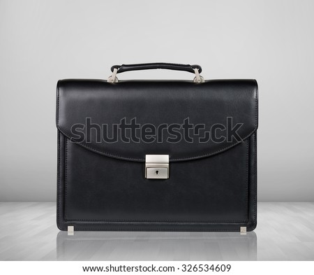Black leather briefcase isolated on the gray background - stock photo