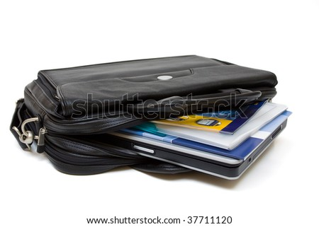 Black leather computer bag with laptop and folders isolated on white background - stock photo