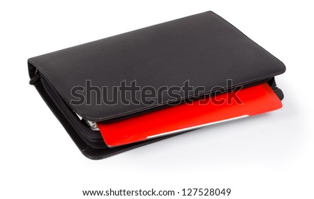 Black leather diary with a colourful red tab for organizing and scheduling your time or taking notes isolated on white - stock photo