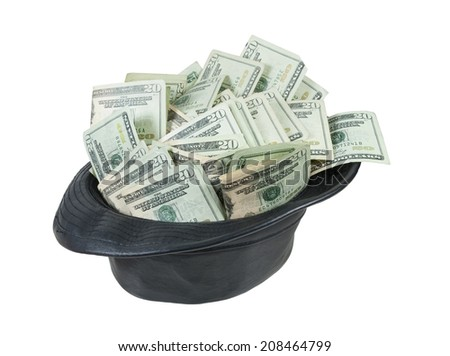 Black leather Fedora hat for an updated fashionable look full of large amount of money - path included - stock photo