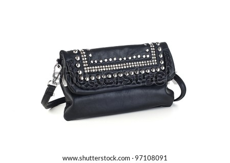 Black leather handbag with silver metal studs, jewels, and strap, white background - stock photo