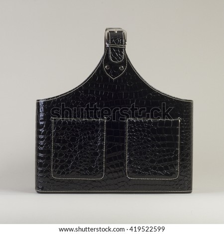 Black Leather Magazine Holder on gray background side view - stock photo