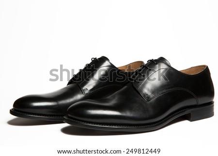 Black leather men's shoes isolated on white background - stock photo