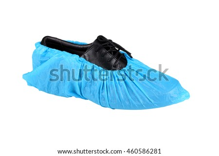 black leather mens shoe in overshoes isolated on white background  - stock photo