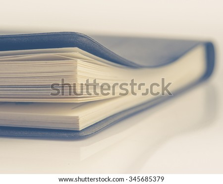 Black leather notebook ,Selective focus ; vintage tone style - stock photo