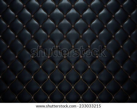 Black leather pattern with diamonds and golden wire. Comfort and luxury - stock photo