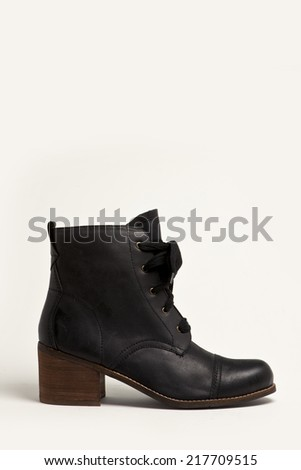 Black leather shoe(boots) side view isolated white. - stock photo