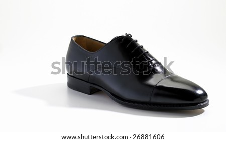 Black leather shoe isolated on a white background - stock photo