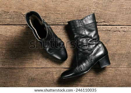 black leather shoes isolated on a wooden plank