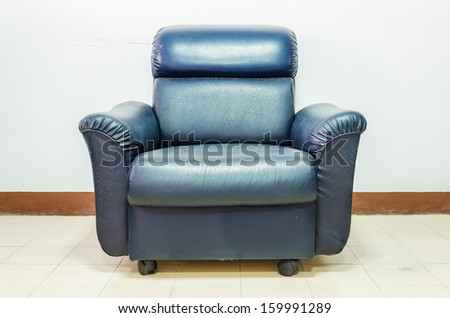 Black leather sofa - stock photo