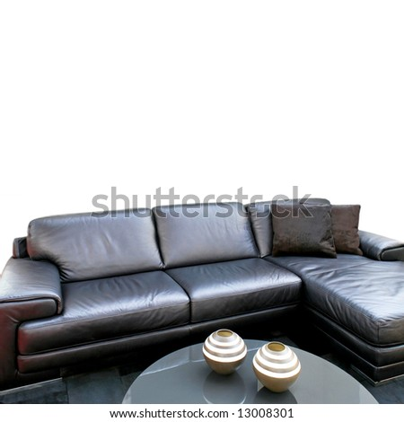Black leather sofa in modern living room - stock photo