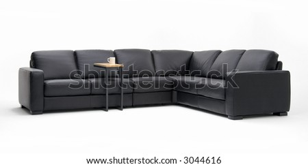 Black leather sofa sectional - stock photo
