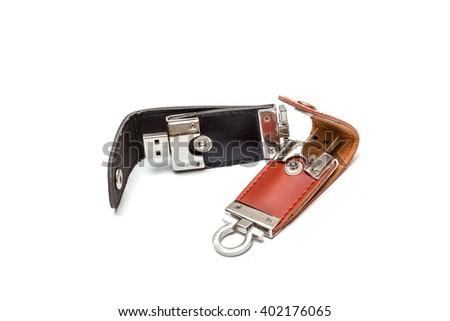 black leather USB stick isolated on white background - stock photo