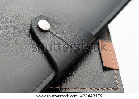 Black leather wallet on white background - close-up