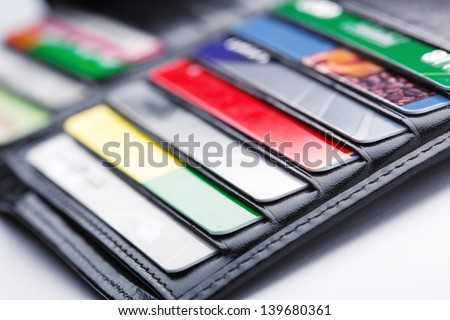 Black leather wallet with credit and discount cards - stock photo