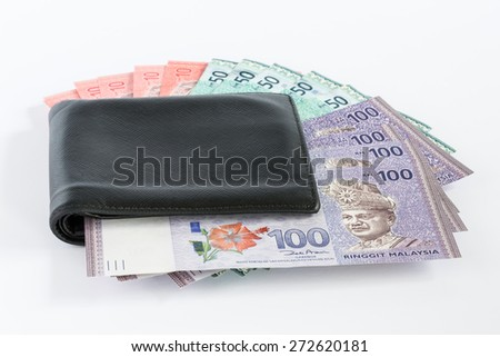 Black leather wallet with Malaysian Ringgit  - stock photo