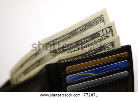Black leather wallet with money and credit cards. White background. - stock photo