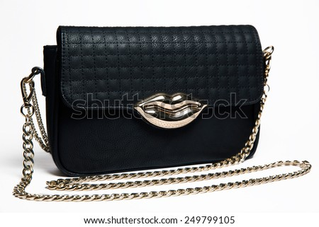 Black leather woman bag with gold lips and chain on white background - stock photo