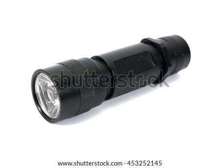 Black LED flashlight isolated on white background.Flashlight isolated - stock photo